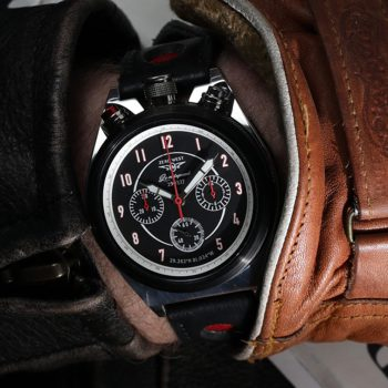 LS-1 Land speed Chronograph from Zero West, on the wrist photograph with lather jacket and glove.